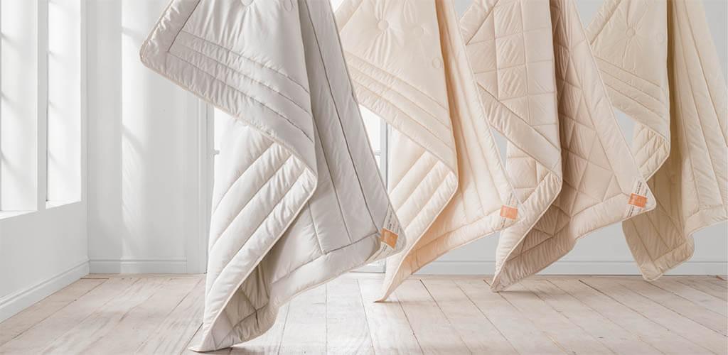Hochwertige-Decken-online-kaufen-Abbildung-dormiente-Naturdecken